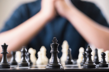 Businessman play with chess game. concept of business strategy and leadership