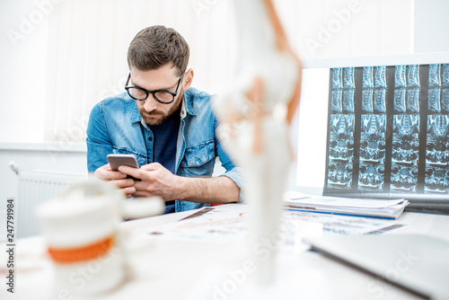 Man Using Smartphone Sitting Hunched Down Having Scoliosis In The