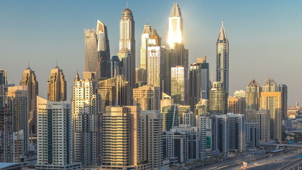 Dubai Marina towers during sunset aerial timelapse, United Arab Emirates