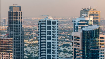 Dubai marina and JLT skyscrapers aerial skyline during sunset timelapse.