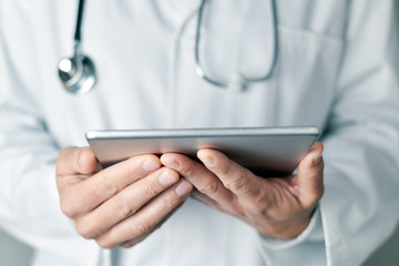 doctor man using a tablet computer