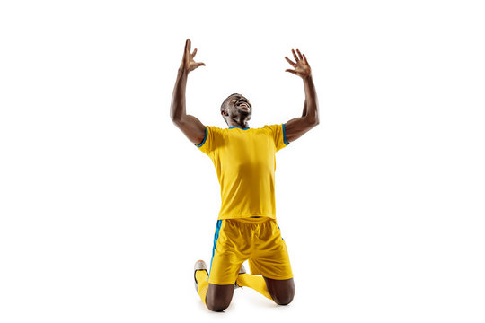 Professional african american football soccer player as winner isolated on white studio background. The win, goal, victory, celebration, happy human emotions concept