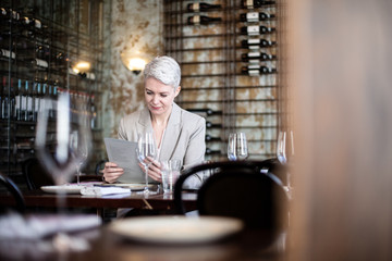 Businesswoman reading menu in a restaurant