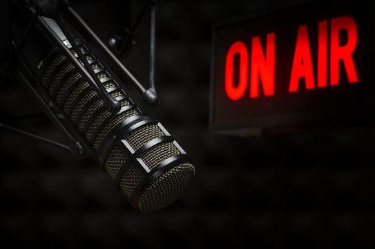 Professional microphone in radio studio on air