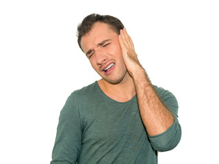 Photo of sick male having ear pain touching his painful head isolated on gray background