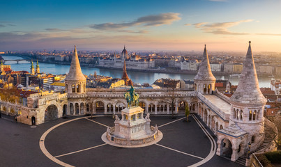 Budapest, Hungary - The famous Fisherman's Bastion at sunrise with statue of King Stephen I and Parliament of Hungary at background