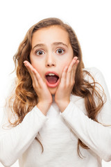 Surprised and horrified young girl looking at camera with eyes wide-opened isolated on white background