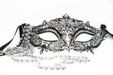 Carnival mask with a necklace on a white background