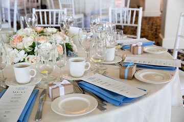 Wedding table decoration series - tables set for beautiful indoor catered luxury wedding event with blue napkins