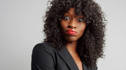 black businesswoman wondering looking to the camera