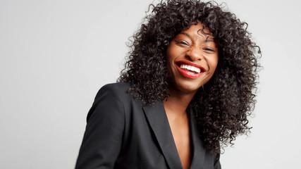 happy laughing businesswoman in studio shoot