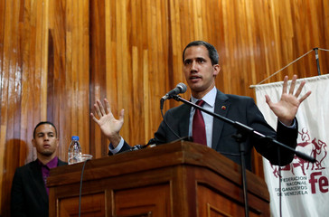 Venezuelan opposition leader Juan Guaido attends a meeting with representatives of FEDEAGRO in Caracas