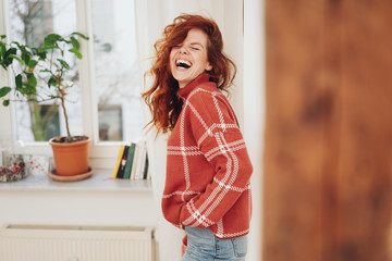 Exuberant young woman laughing out loud