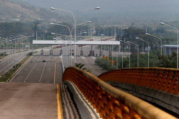 Barricades of tires block the vehicular passage at the Tienditas cross-border bridge between Colombia and Venezuela, in Cucuta