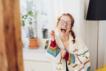 Very happy young girl singing or screaming
