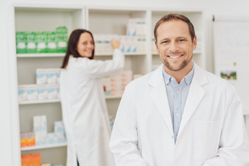 Attractive male pharmacist with a friendly smile