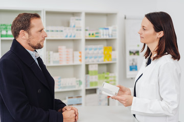 Female pharmacist discussing a script