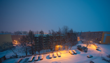 Snow in the night city,