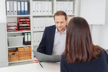 Businessman looking at files during interview