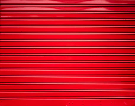 Background and texture of red color corrugated metal sheet,Slide door ,Roller shutter texture with shadow and hilight effect.