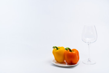 Alcoholic drinks such as wine or beer and variable colorful side dish such as vegetables or fruites surrounded clean white wall for the celebration of anniversary day.
