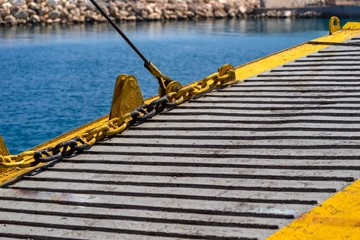 fragment of the big iron ladder of the sea vessel or the ferry which is spread out over water a closeup