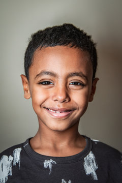Happy African American boy smiling in a studio