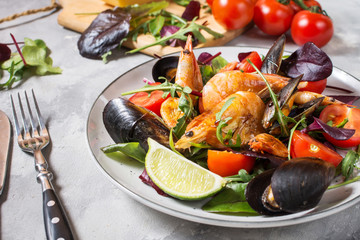 Seafood salad, mussels, shrimp, fresh vegetables and herbs.