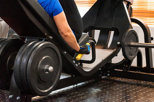 Fitness weight plates on exercise machine in gym