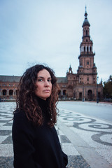 Woman visiting Plaza of Spain (Plaza España) in Seville, the capital of Andalusia. One of the symbols of the city, a popular object for tourists.