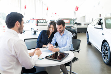 Couple Signing Vehicle Lease Agreement