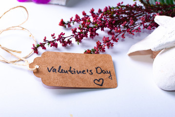 """An arrangement for luxury wellness gift ideas and cards with a tag saying """"Valentine's Day"""""""