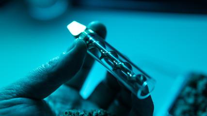 smoking accessories for marijuana close-up. Glass blunt for smoking cannabis