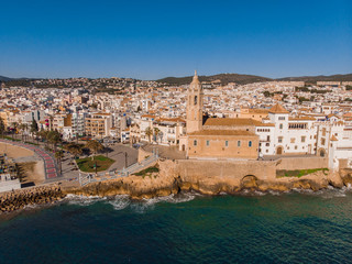 Sitges city view from a drone with the port and the beach of catalunia in a holiday village