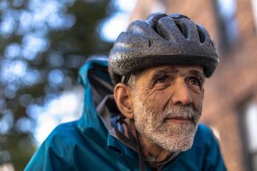 portrait of senior man biking