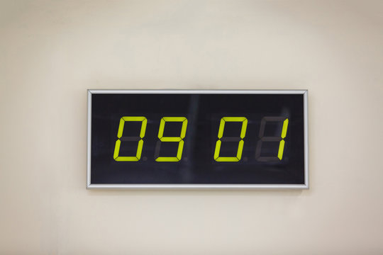 Black digital clock on a white background showing time 09.01 minutes