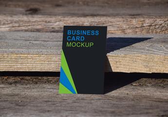 Vertical Business Card on Wood Background Mockup