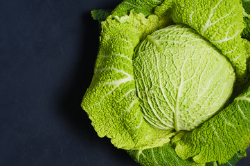 Savoy cabbage. Dark background, top view