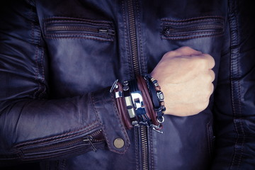 Hand of rocker in leather  bracelet and accessory .Hard rock, heavy metal,gothic and punk style.Brutal jacket