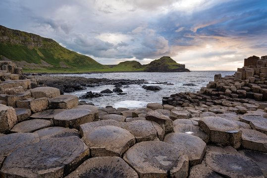 Basalt columns by the coast at sunset, Giant's Causeway, County Antrim, Northern Ireland, United Kingdom, Europe