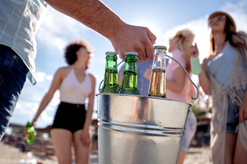 Friends with beers on the beach