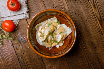 Dumplings with sour cream and herbs