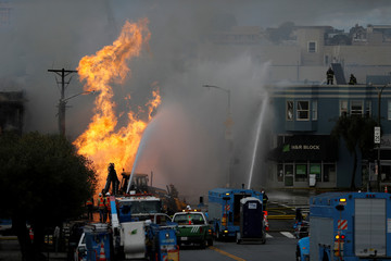 Firefighters battles a fire after a gas line explosion in San Francisco