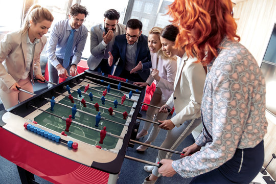 Coworkers playing table football