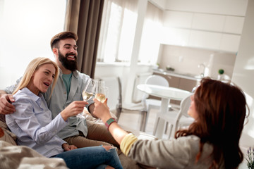 Friends toasting in living room
