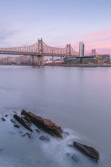Aerial view on Queensboro bridge from East River at sunset with long exposure