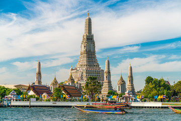 Wall Mural - Temple of dawn Wat Arun with Chao Praya river sightseeing landmark of Bangkok