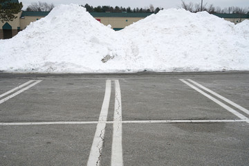 parking lots with snow pile in winter