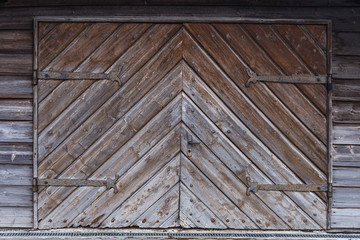 Old wooden gate with metal decorations in the ancient German town of Fussen