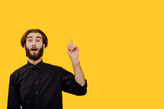 Thinking man having idea. evrika,  Closeup portrait intelligent  young man who just came up with an idea aha, isolated yellow background. Positive emotion facial expression feeling, copy space